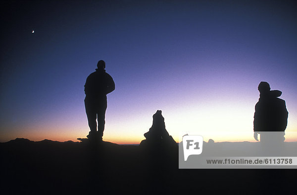 Silhouette of campers at sunset