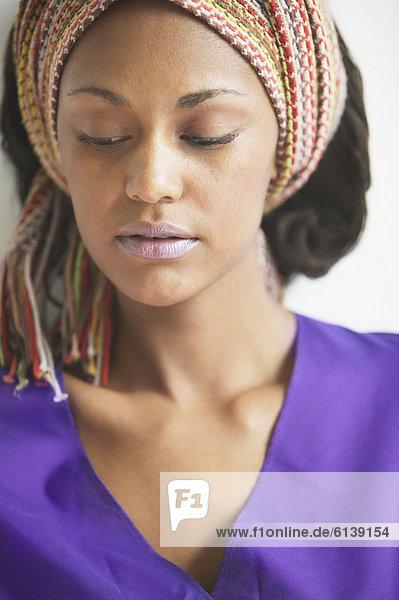 Close up of woman wearing headscarf