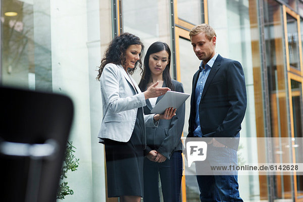 Business colleagues with digital tablet