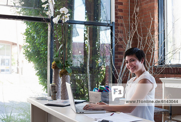 Businesswoman at desk using laptop