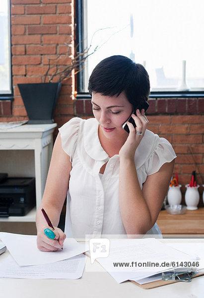 Businesswoman in office on phone  portrait
