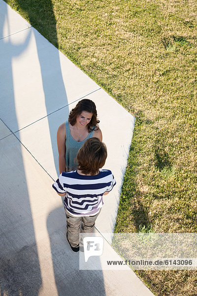 Teenage couple standing on path from above