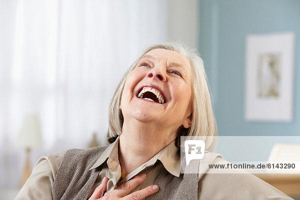 Senior woman laughing  portrait