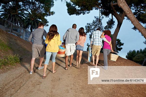 Friends walking back from beach