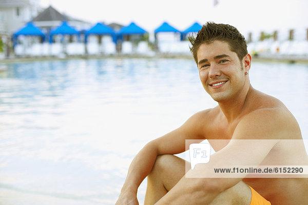 sitzend  Mann  jung  schwimmen