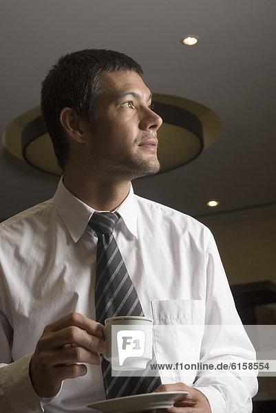 Geschäftsmann  Hispanier  trinken  Kaffee
