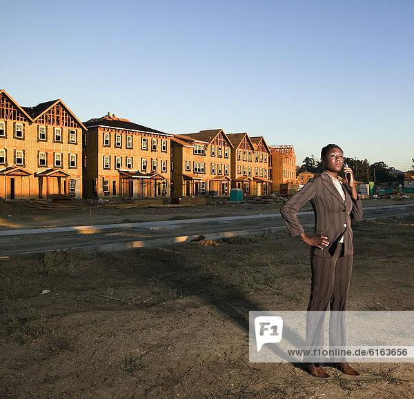 bauen Geschäftsfrau amerikanisch Nachbarschaft