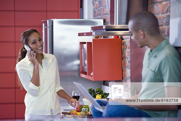 African American couple in kitchen
