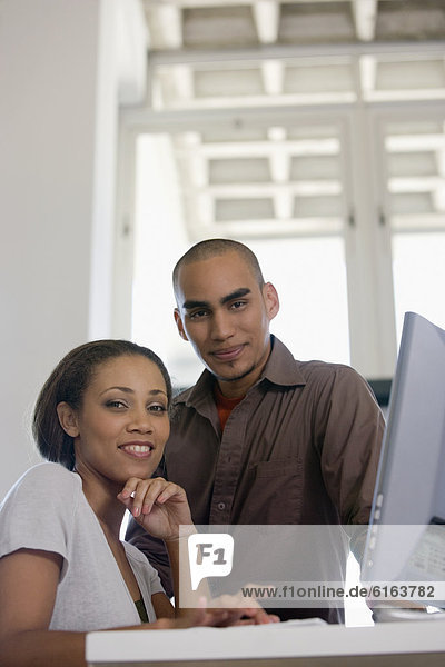 African American couple next to computer