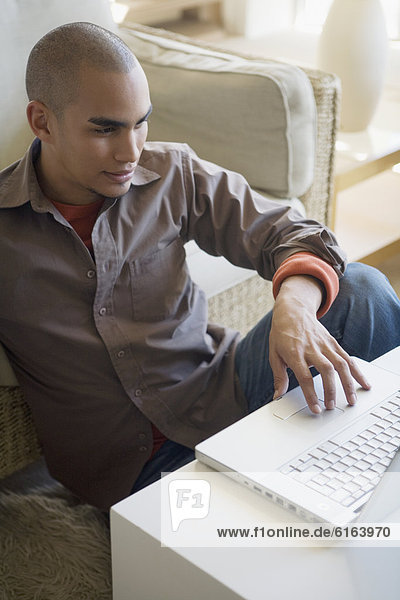 African American man looking at laptop