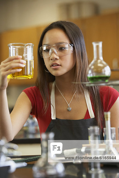 Asian teenaged girl in science class