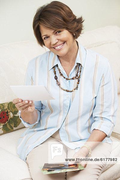 Senior Hispanic woman looking at photographs