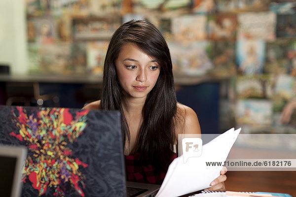 Asian girl studying on laptop