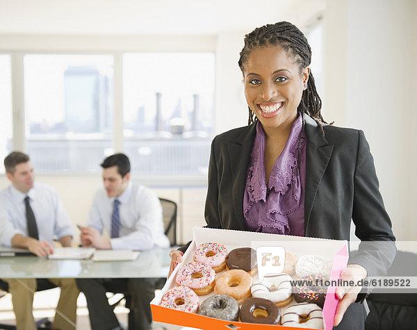 Geschäftsfrau  tragen  amerikanisch  Donut