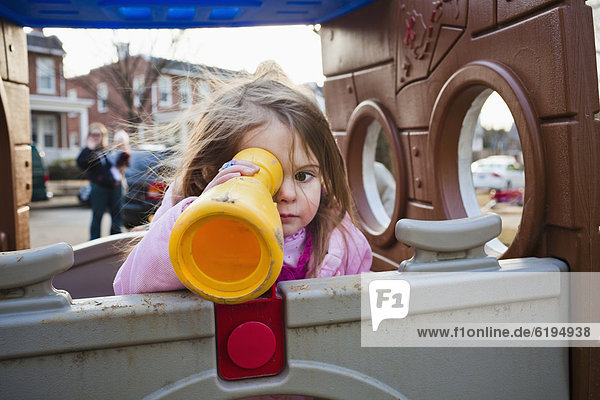 Caucasian girl playing in playground