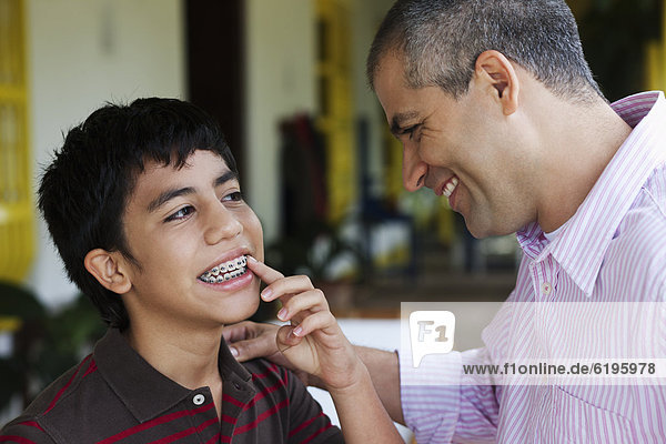 Boy showing father his braces