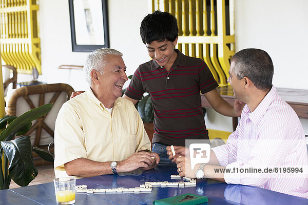 Grandfather and grandson playing dominoes