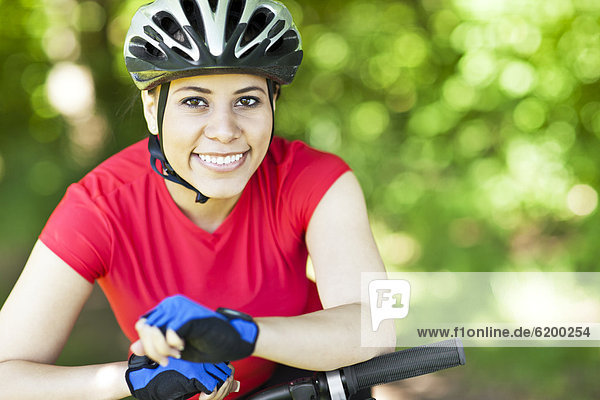 Hispanic woman riding mountain bike