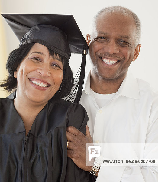 African woman graduate with husband