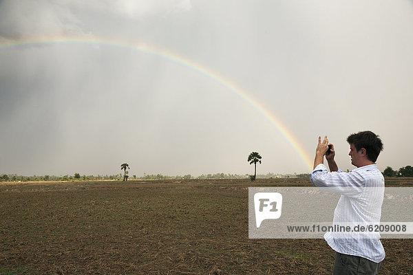 Mann  Fotografie  nehmen  Regenbogen