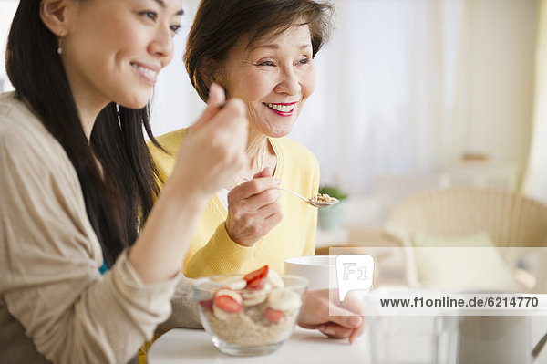 Japanese mother and daughter having breakfast together