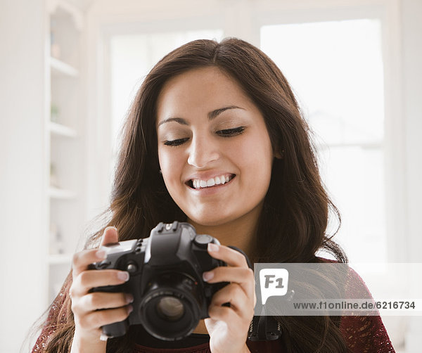 Mixed race woman looking at camera