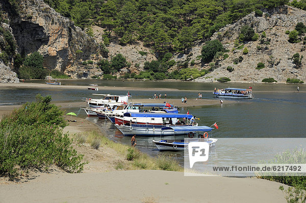 Excursion boats on a river  river delta in the nature preservation area between Caunos and Iztuzu Beach  Dalyan  Mugla Province  Turkey  Asia Minor