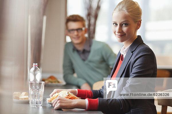 Businesswoman having lunch in a restaurant