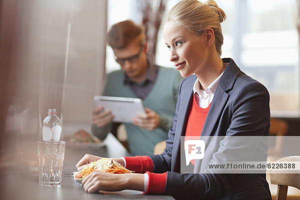 Businesswomen having lunch in a restaurant