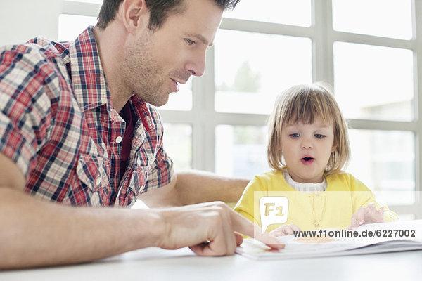 Man teaching his daughter