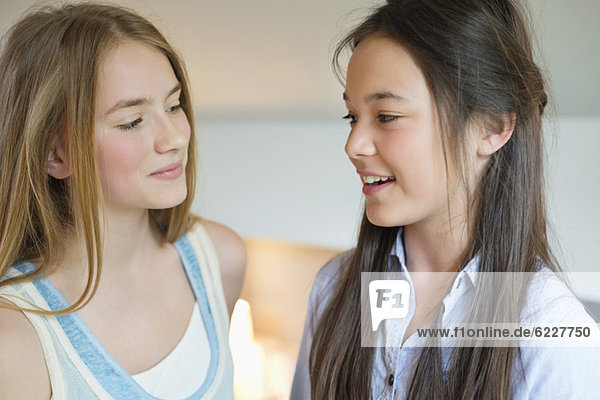 Close-up of two girls smiling