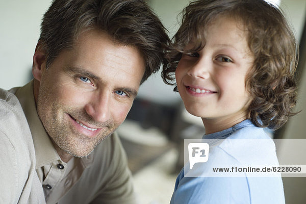 Portrait of a man with his son smiling
