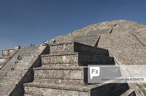 Tourists climbing stairway  Pyramid of the Moon  Archaeological Zone of Teotihuacan  UNESCO World Heritage Site  Mexico  North America