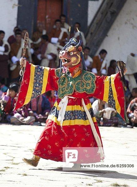 Buddhist monks performing masked dance during the Gangtey Tsechu at Gangte Goemba  Gangte  Phobjikha Valley  Bhutan  Asia