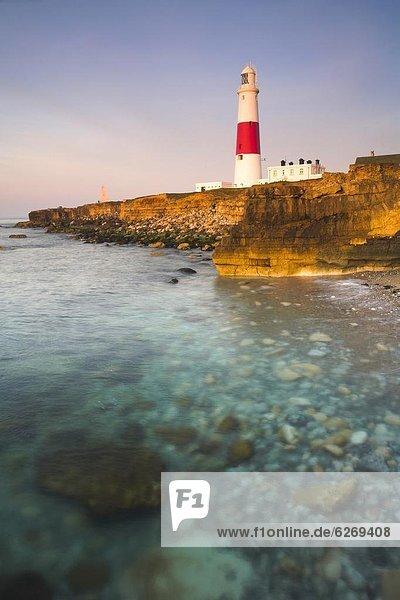 Schnabel  hoch  oben  Europa  Sonnenstrahl  Morgen  Großbritannien  Beleuchtung  Licht  Leuchtturm  früh  UNESCO-Welterbe  Rechnung  Dorset  England