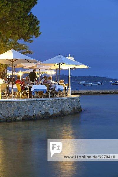 Waterfront restaurant in the evening  Port de Pollenca (Puerto Pollensa)  Mallorca (Majorca)  Balearic Islands  Spain  Mediterranean  Europe