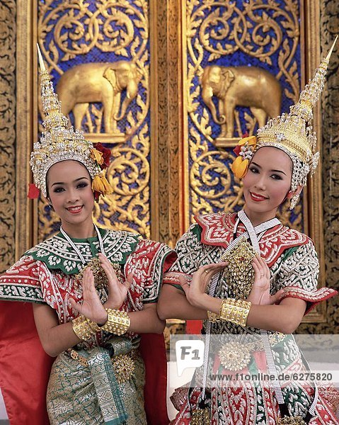Portrait of two dancers in traditio0l Thai classical dance costume  smiling and looking at the camera  Bangkok  Thailand  Southeast Asia  Asia