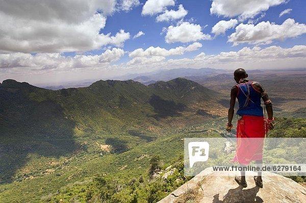 Samburu man looks down over the Ewaso Rongai Valley from Mount Nyiru  Northern Frontier  Kenya  East Africa  Africa