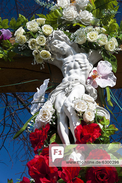 Crucifix decorated with flowers  in Tarnow  Lesser Poland  Poland  Europe