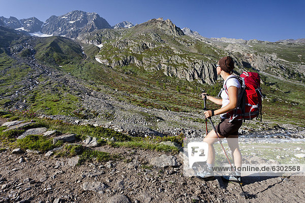 Hiker walking on the Merano High Mountain Trail  view during the ascent to Hohe Wilde mountain in the Pfossental valley  Schnalstal valley  province of Bolzano-Bozen  Italy  Europe