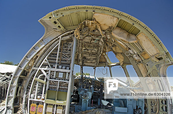 An airliner's cockpit in a scrapyard for aircraft parts  El Mirage  California  USA