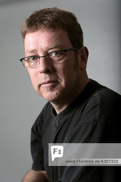 Tilburg  Netherlands. Studio portrait with natural light of an adult male wearing glasses due to his poor eyesight.