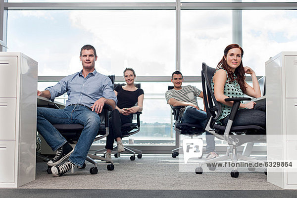 Creative business people sitting at workstations