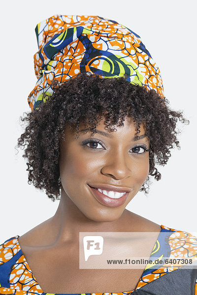 Portrait of an African American woman smiling over gray background