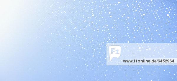 Gebogenes Punktmuster vor blauem Hintergrund