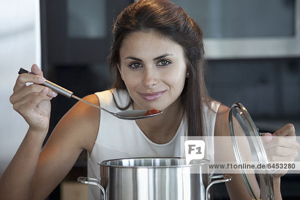 Elegant woman bring ladle to mouth