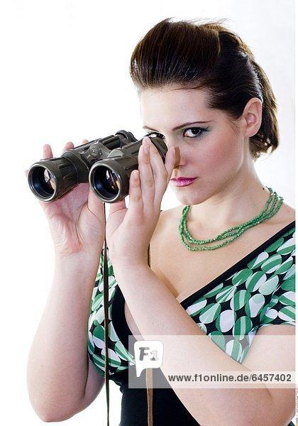 Junge Frau mit Fernglas *** Local Caption ***