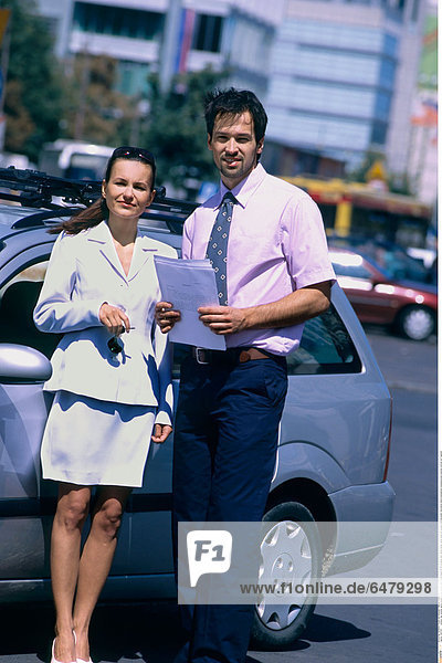 1227313 outdoor day summer spring people young woman man couple beard 25-30 brunette dark haired jacket white dress tie trousers hold document documents stand businessman businesswoman business vertical car fragment
