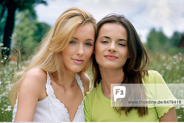 1228751 outdoor day summer people woman girl young 20-25 blonde long haired hair meadow field rest relax vacation smile smiling women girls sister sisters friend friends friendship dress white blouse brunette close up portrait horizontal