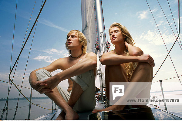 1233504 outdoor water lake day summer people couple young woman man girl boy 20-25 blonde long hair fair haired sit body barefoot foot feet sailing boat sailingboat look rest vacation holidays recreation sailing yachting close up horizontal